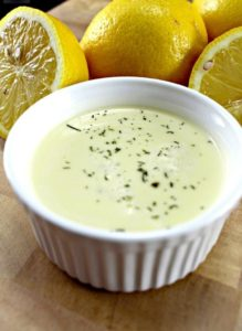 Lemon-and-Garlic-Sauce-ramikin-with-fresh-cut-lemons