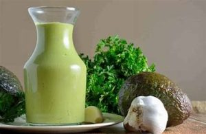 green goddess sauce in a glass jar with ingredients